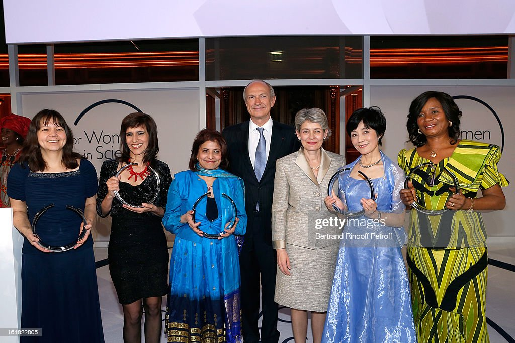 Physicist Deborah S. Jin (Graduate 2013 for North America), Physicist Marcia Barbosa (Graduate 2013 for Latin America), Scientist Professor Pratibha L. Gai (Graduate 2013 for Europe), L'Oreal President Jean-Paul Agon, UNESCO General Director <a gi-track='captionPersonalityLinkClicked' href=/galleries/search?phrase=Irina+Bokova&family=editorial&specificpeople=6324408 ng-click='$event.stopPropagation()'>Irina Bokova</a>, Chemist Professor Reiko Kuroda (Graduate 2013 for Asia and Pacific) and Physics Professor Francisca Nneka Okeke (Graduate 2013 for Africa and Arab States) attend 'L'Oreal-UNESCO Awards' For Women In Science 2013 - Ceremony at La Sorbonne on March 28, 2013 in Paris, France.