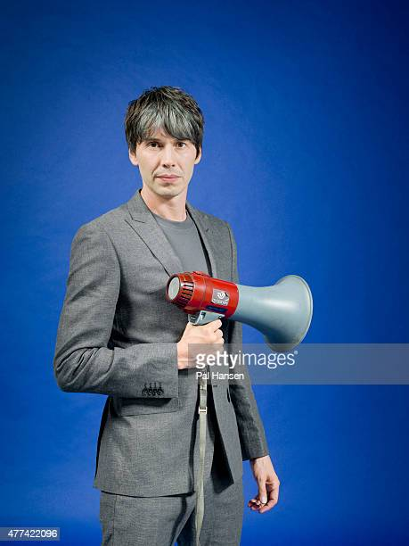 Physicist professor of particle physics and tv presenter Brian Cox is photographed for FHM magazine on August 20 2014 in London England