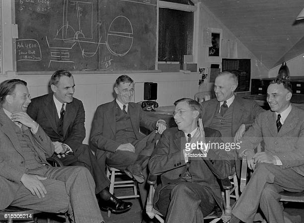 Physicists meet at the Radiation Laboratory at the University of California Berkeley to discuss the 184inch cyclotron Left to right are Ernest O...