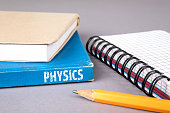 physics concept. blue book on a gray office table. communication and information