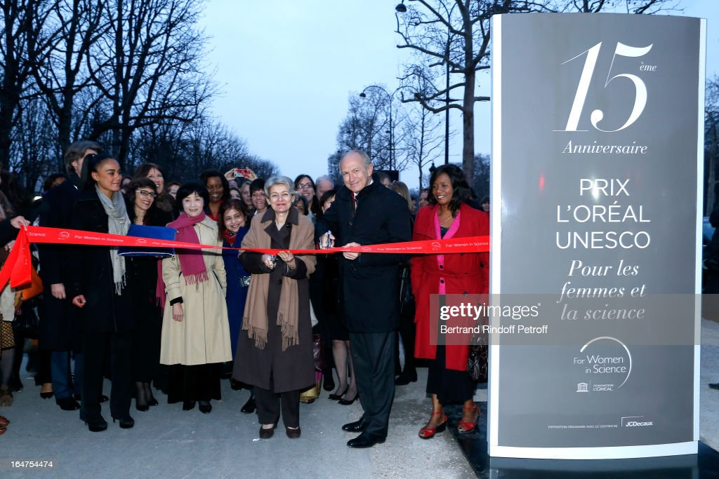 Physics Professor Francisca Nneka Okeke (Graduate 2013 for Africa and Arab States), L'Oreal President Jean-Paul Agon, UNESCO General Director <a gi-track='captionPersonalityLinkClicked' href=/galleries/search?phrase=Irina+Bokova&family=editorial&specificpeople=6324408 ng-click='$event.stopPropagation()'>Irina Bokova</a>, Scientist Professor Pratibha L. Gai (Graduate 2013 for Europe), Chemist Professor Reiko Kuroda (Graduate 2013 for Asia and Pacific) attend Opening of Photo Exhibition for the 15th anniversary of 'L'Oreal-UNESCO Awards For Women In Science' At the Champs Elysees on March 27, 2013 in Paris, France.