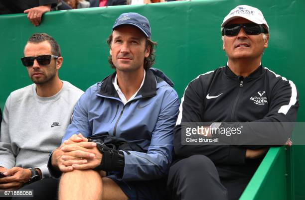Physio Rafael Maymo Carlos Moya and Toni Nadal coaches of Rafael Nadal of Spain watch him play against Albert RamosVinolas of Spain in the final on...