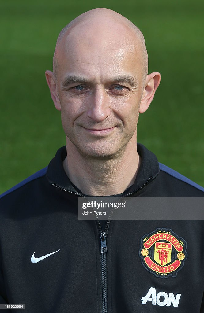 Physio <a gi-track='captionPersonalityLinkClicked' href=/galleries/search?phrase=Rob+Swire&family=editorial&specificpeople=1268687 ng-click='$event.stopPropagation()'>Rob Swire</a> of Manchester United poses at the annual club photocall at Old Trafford on September 26, 2013 in Manchester, England.