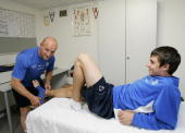 Physiotherapist Georg Baumann treats a youth footballer in the doctor's room of the DietmarHoppYouthPromotionCentre during the TSG Hoffenheim report...