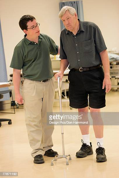 Physiotherapist helping a patient to walk