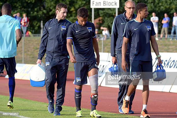physiotherapist Michael Becker Sami Allagui and team doctor Dr med Ulrich Schleicher and physiotherapist Frederick Syna of Hertha BSC during the game...