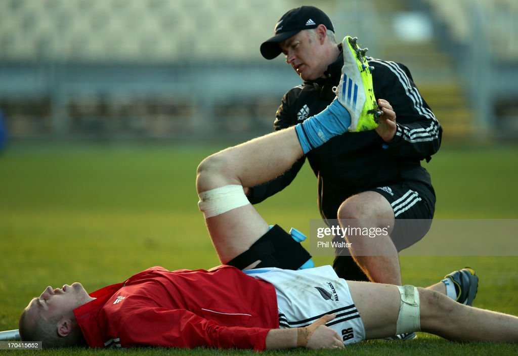 Physiotherapist Peter Gallagher attends to <a gi-track='captionPersonalityLinkClicked' href=/galleries/search?phrase=Brodie+Retallick&family=editorial&specificpeople=7864021 ng-click='$event.stopPropagation()'>Brodie Retallick</a> of the All Blacks during a New Zealand All Blacks training session at AMI Stadium on June 13, 2013 in Christchurch, New Zealand.