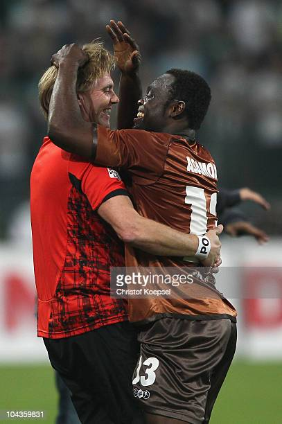 Physiotherapist Peter Ott celebrates the first goal with gerald Asamoah during the Bundesliga match between Borussia Moenchengladbach and FC St Pauli...