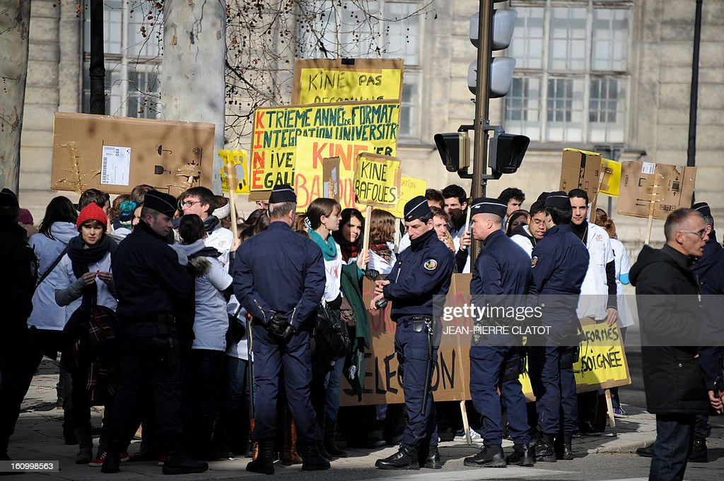 Physiotherapist students face anti-riot police as they protest against poor training conditions ahead of the arrival of the French Prime Minister at the Isere prefecture on February 8, 2013 in Grenoble, French Alps. French Prime Minister Jean-Marc Ayrault will deliver a speech focused on the government's health strategy.