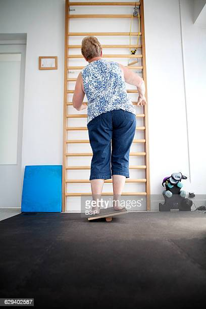 Physiotherapist vestibular rehabilitation on patients who are suffering from vertigo balance disorders relating to the inner ear A patient does some...