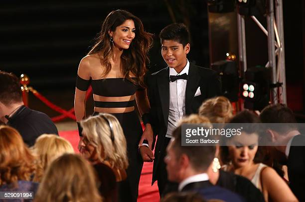 Pia Miller and her son Isaiah Loyola arrive at the 58th Annual Logie Awards at Crown Palladium on May 8 2016 in Melbourne Australia