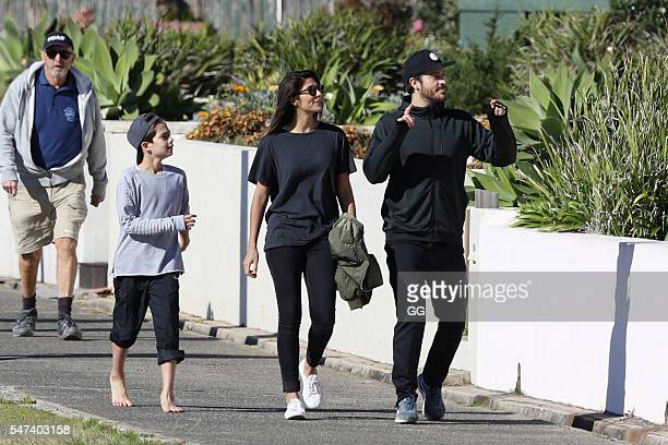 Pia Miller and her son Lennox and boyfriend Tyson Mullane enjoy a day at the beach on July 3 2016 in Sydney Australia