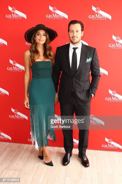 Pia Miller and Tyson Mullane poses at the GH Mumm Marquee on Melbourne Cup Day at Flemington Racecourse on November 7 2017 in Melbourne Australia