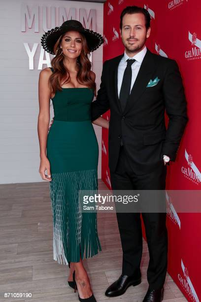 Pia Miller and Tyson Mullane poses at the Mumm Marquee on Melbourne Cup Day at Flemington Racecourse on November 7 2017 in Melbourne Australia