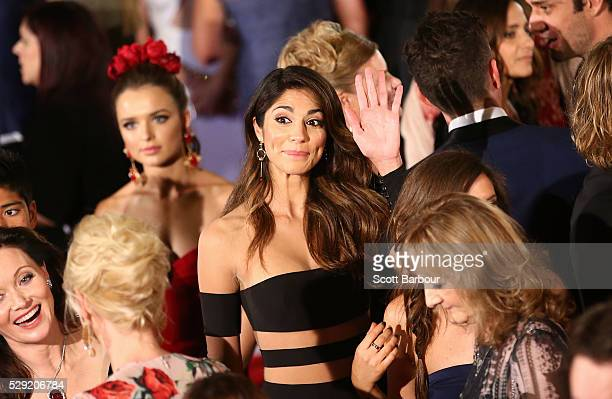 Pia Miller waves as she arrives at the 58th Annual Logie Awards at Crown Palladium on May 8 2016 in Melbourne Australia