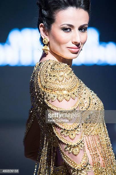 Pia Trivedi walks on stage during the inaugural amfAR India event at the Taj Mahal Palace Mumbai on November 17 2013 in Mumbai India