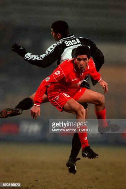 LR Piacenza's Alessandro Lucarelli is challenged by Udinese's Roberto Carlos Sosa