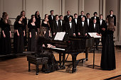 Pianist and choir performing on stage