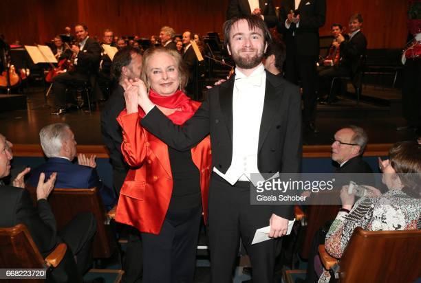 Pianist Daniil Trifonov receives the 'Herbert von Karajan award' from Eliette von Karajan widow of Herbert von Karajan while the 'Konzert fuer...
