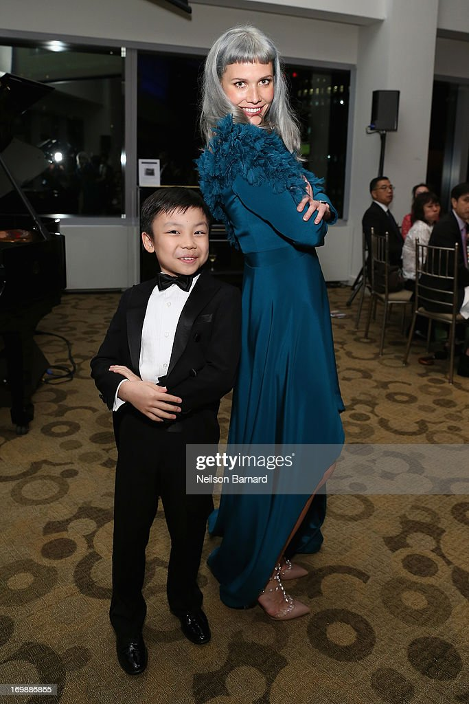 Pianist Johnson Zhongxin Li poses with singer <a gi-track='captionPersonalityLinkClicked' href=/galleries/search?phrase=Oh+Land&family=editorial&specificpeople=6129247 ng-click='$event.stopPropagation()'>Oh Land</a> at The Lang Lang International Music Foundation Inaugural Gala supported by Montblanc at 10 on The Park on June 3, 2013 in New York City.
