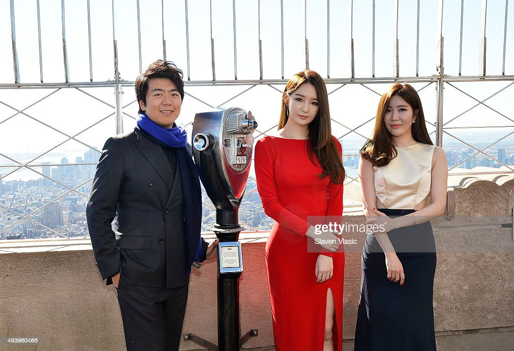 Pianist <a gi-track='captionPersonalityLinkClicked' href=/galleries/search?phrase=Lang+Lang&family=editorial&specificpeople=589153 ng-click='$event.stopPropagation()'>Lang Lang</a>, Kang Minkyung and Lee Haeri of pop duo Davichi visit The Empire State Building on October 23, 2015 in New York City.