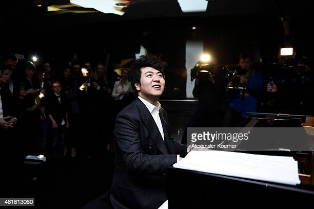 Pianist Lang Lang plays the piano during the 'Amazing Lang Lang' World Premiere Fragrance Launch at Galeries Lafayette on January 19 2015 in Berlin...