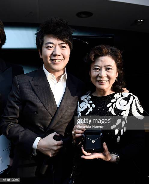 Pianist Lang Lang poses with his mother Xiluan Zhou during the 'Amazing Lang Lang' World Premiere Fragrance Launch at Galeries Lafayette on January...