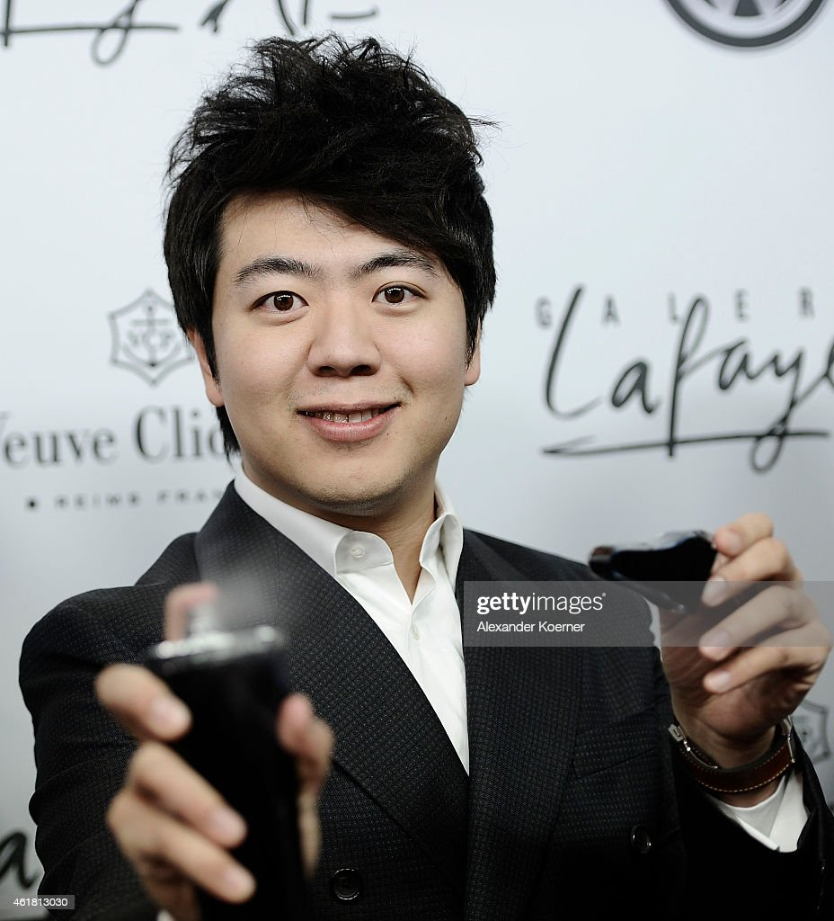 Pianist <a gi-track='captionPersonalityLinkClicked' href=/galleries/search?phrase=Lang+Lang&family=editorial&specificpeople=589153 ng-click='$event.stopPropagation()'>Lang Lang</a> presents his new fragrence during the 'Amazing <a gi-track='captionPersonalityLinkClicked' href=/galleries/search?phrase=Lang+Lang&family=editorial&specificpeople=589153 ng-click='$event.stopPropagation()'>Lang Lang</a>' World Premiere Fragrance Launch at Galeries Lafayette on January 19, 2015 in Berlin, Germany.