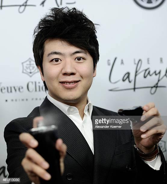 Pianist Lang Lang presents his new fragrence during the 'Amazing Lang Lang' World Premiere Fragrance Launch at Galeries Lafayette on January 19 2015...