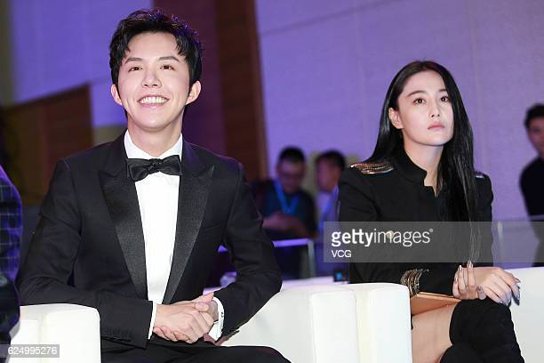 Pianist Li Yundi and actress Zhang Xinyu attend a strategic conference on November 21 2016 in Beijing China