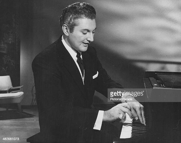 Pianist Liberace performing on the Warner Brothers sound stage Los Angeles California circa 1955