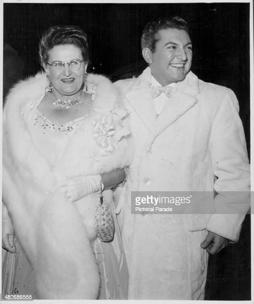 Pianist Liberace with his mother attending a premiere circa 1960