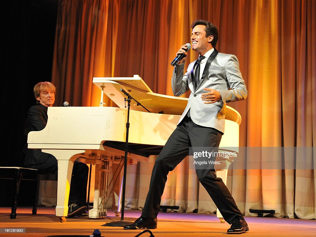Pianist Mark Vogel and singer David Burnham perform at the 12th Annual Heller Awards at The Beverly Hilton Hotel on September 19, 2013 in Beverly Hills, California.