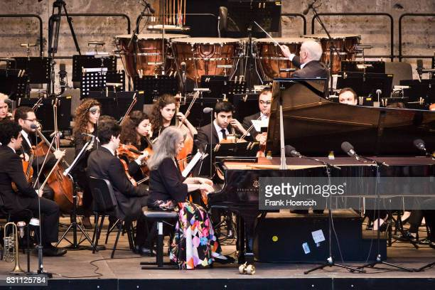 Pianist Martha Argerich Daniel Barenboim and the WestEastern Divan Orchestra perform live during a concert at the Waldbuehne on August 13 2017 in...