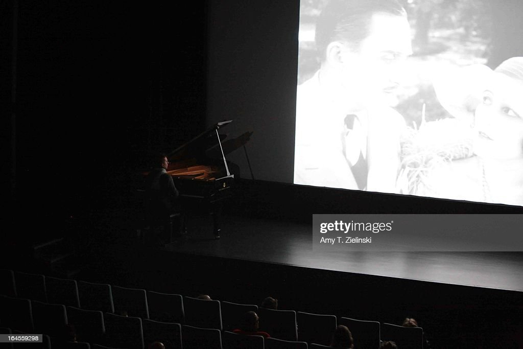 A pianist performs with a Steinway grand piano during a silent movie on stage in Cine Lumiere during 'It's All About Piano!' festival inside the The Institut Francais on March 24, 2013 in London, England. The festival is a collaboration from French Music Office to celebrate the piano with recitals from classical to jazz, film screenings, children's activities, workshops and cinema screenings exploring the musical instrument.