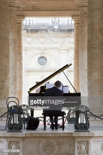 Pianist playing piano outdoors : Stock Photo