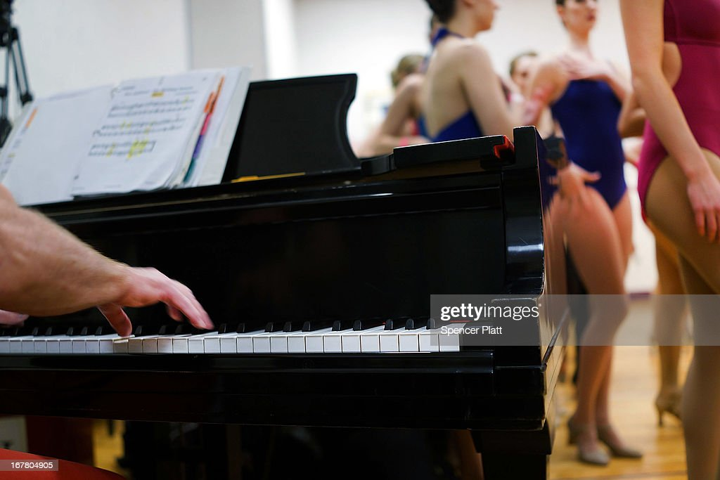 A pianist plays music as women audition at Radio City Music Hall for a spot with the Rockettes on April 30, 2013 in New York City. In order to be considered for the Rockettes, dancers must be at least 18 years old, measure at a height between 5 feet 6 inches and 5 feet 10 1/2 inches without their heels on. The dancers must also be be proficient in numerous dance styles, including jazz, tap and ballet. The women who make it through the extremely competitive competition to land a spot with the legendary dance group will perform in the Radio City Christmas Spectacular which runs from November 8 -December 30 2013.