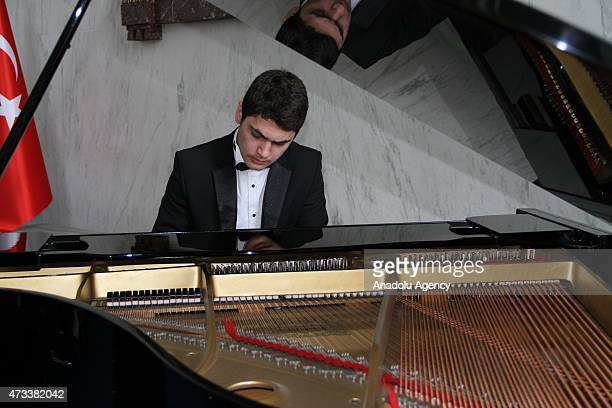 Pianist Tambi Asaad Cimuk performs a piano recital during an organization held to raise awareness of Syrian conflict on May 14 2015 at Rayburn House...