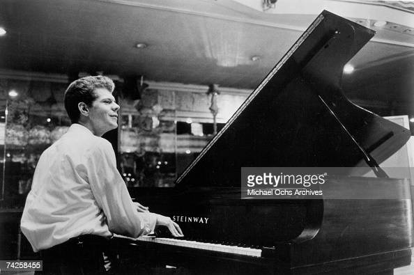 Pianist Van Cliburn plays the piano on stage in 1968