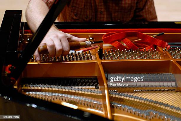 Piano and piano tuner hands