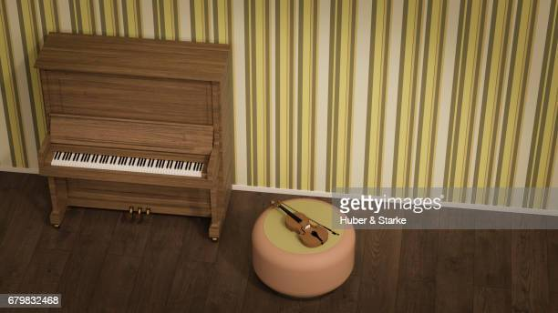 piano and violin in front of old fashioned wallpaper