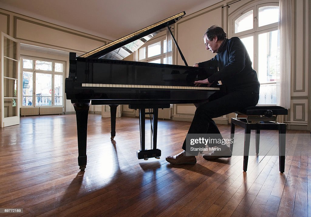 Piano being tuned in empty apartment
