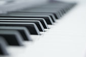 Piano is a musical instrument classified as a percussion instrument that is played by pressing keys on a keyboard. Each key is a lever that makes a hammer inside the piano hit a string inside, produci
