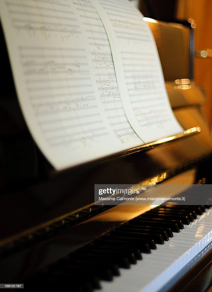 Piano keyboard with musical scores : Stock Photo