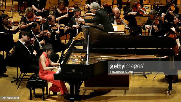 MAR 24 2015 Piano soloist Yuja Wang with Michael Tilson Thomas conducting the London Symphony Orchestra in Gershwin's 'Piano Concerto in F ' at Walt...
