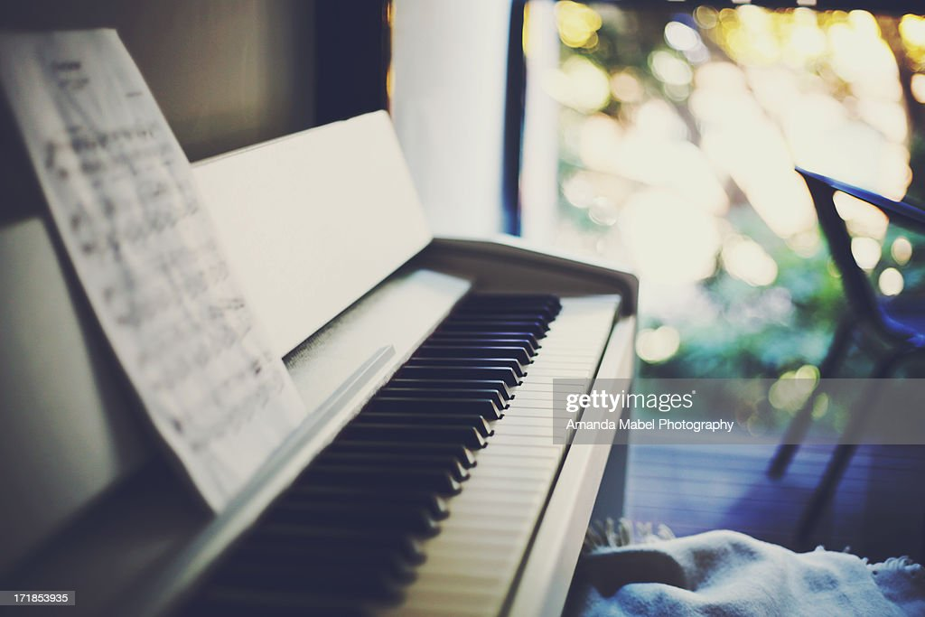 Piano with Balcony and Bokeh in the Background : Stock Photo