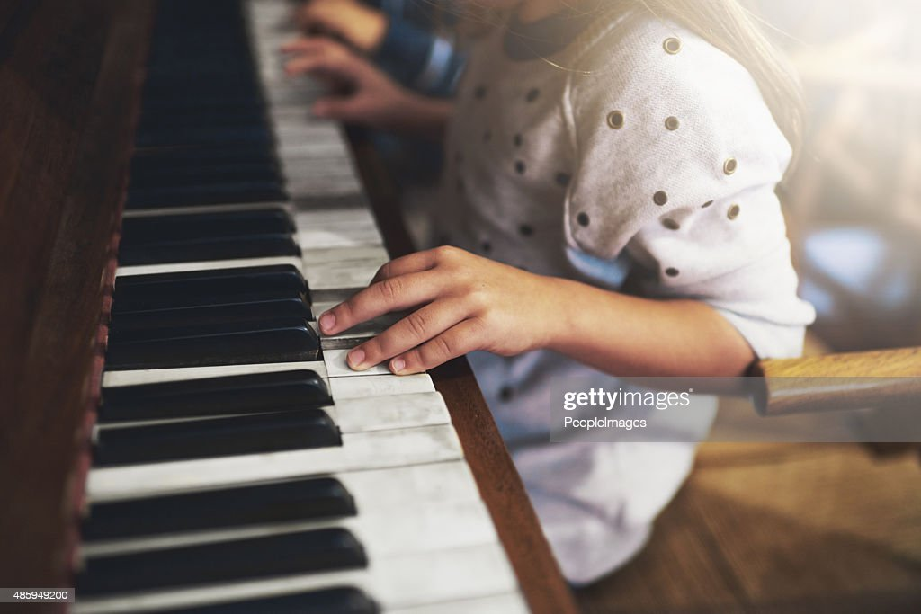 Pianos unlock the keys to childhood talent : Stock Photo