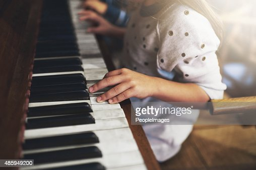 Pianos unlock the keys to childhood talent : Stock Photo