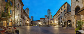 Panoramic view of famous Piazza della Cisterna in the historic town of San Gimignano on a morning, Tuscany, Italy.