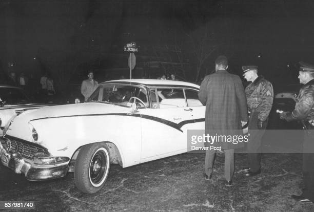Pic No 4Officers at right inspect the stolen car abandoned by two men at E Bayaud Ave and S Lincoln St seconds before the slaying Officers are from...